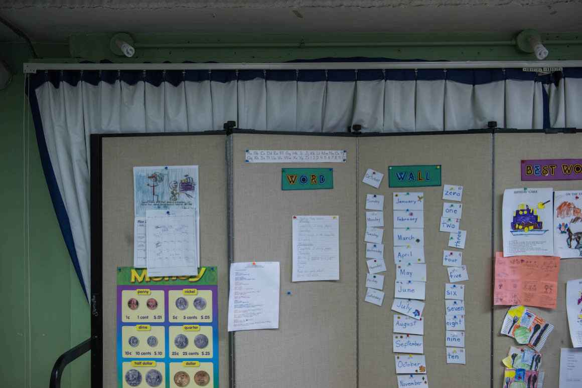 """A teacher's """"Word Wall,"""" in the special-education classroom in the Sodus schoolhouse, sits on the stage unless there's a school production. The entire classroom must be disassembled when school productions take place."""